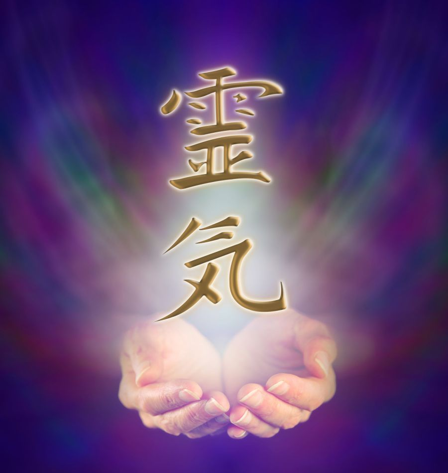 28264538 - healers cupped hands and reiki kanji symbol on misty background